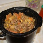 A crockpot filled with beef stew.